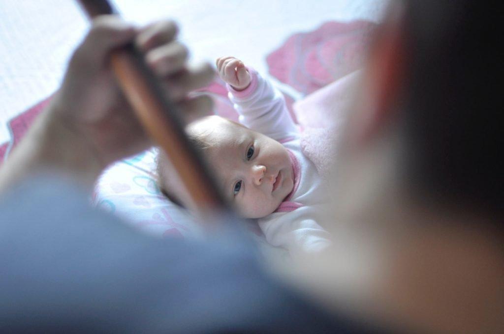 Dad playing guitar for NICU baby